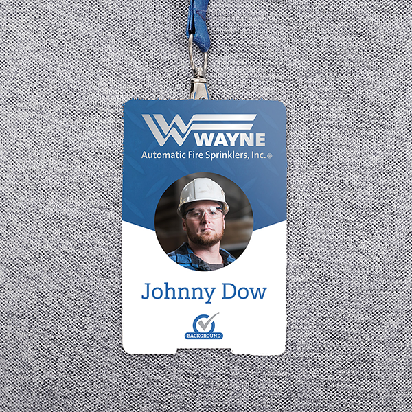 A Wayne badge and lanyard featuring a placeholder person