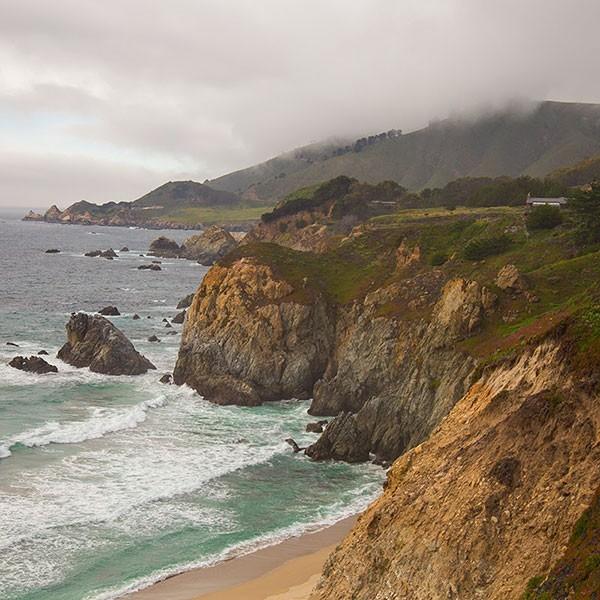 An image of a cliffside beside an ocean.