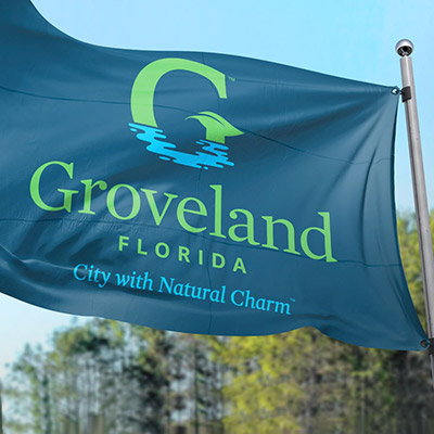 Teal flag featuring the new City of Groveland logo