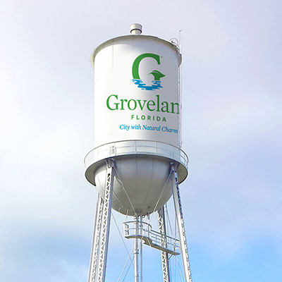 A water tower featuring the new City of Groveland logo.