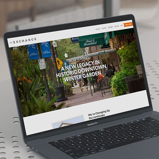 The Exchange website on a laptop.